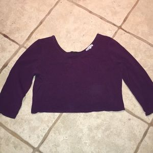 Long sleeve purple crop top with an open back